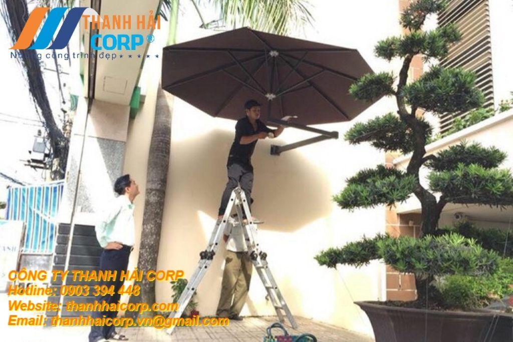 lắp đặt ô dù treo tường